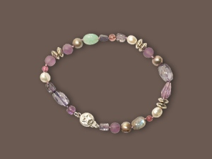 Bracelet of tourmalines, chalcedony, iolite, amethyst, agate, labradorite, freshwater pearls and sterling silver $55