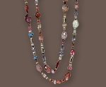 Necklace of 18 karat white gold, rubies and fancy sapphires