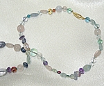 Necklace of 14 karat gold, fluorite, citrine, quartz and iolite