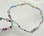 Necklace of 14 karat gold, fluorite, citrine, quartz and iolite