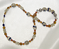 Necklace14 karat gold, garnets, quartz and amber  $155