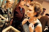 A woman tries on a necklace from Eve's new design series at the 25th Anniversary Event