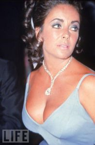 a photo of Elizabeth Taylor adorned with Diamonds on the cover of Life magazine.